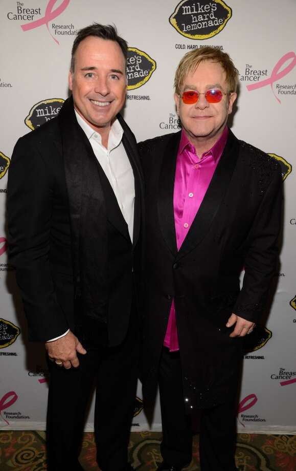 David Furnish and Elton John attend the Breast Cancer Foundation\'s Hot Pink Party at the Waldorf Astoria Hotel on April 17, 2013 in New York City.  (Photo by Kevin Mazur/WireImage)