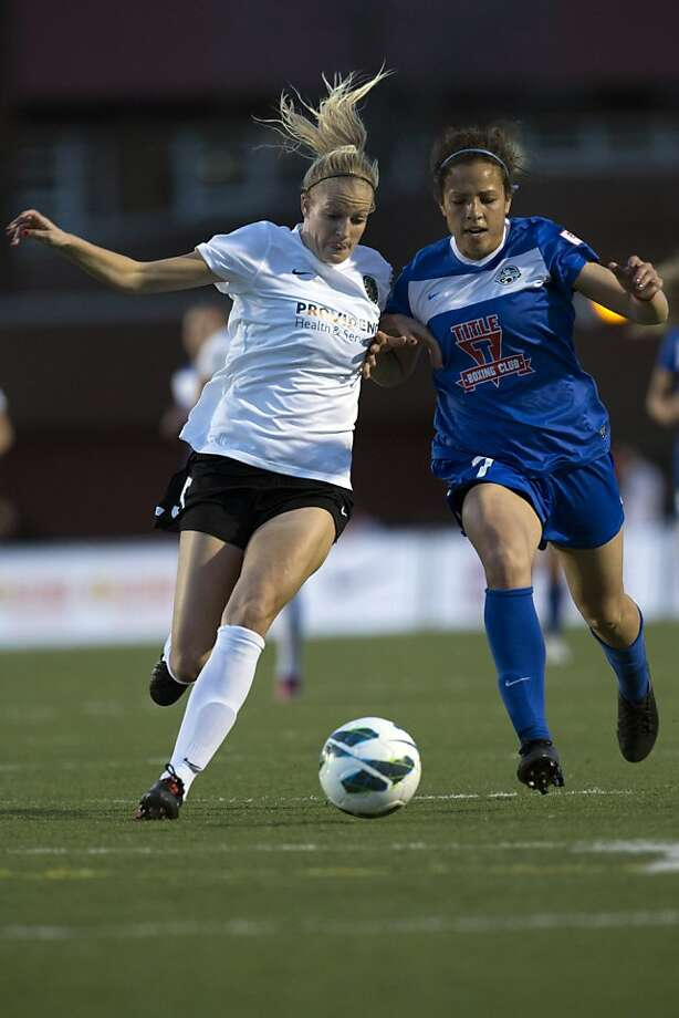 Kathryn Williamson (5) of the Portland Thorns and Casy Loyd (7) of FC Kansas City fight for the ball in Overland Park, Missouri at Shawnee Mission North District Stadium on Saturday, April 13, 2013. (AP Photo/ Kansas City Star, Brian Davidson) Photo: Brian Davidson, Associated Press
