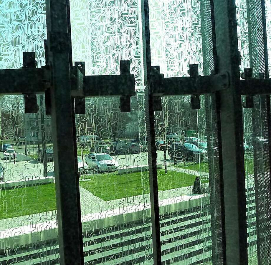 Windows at Warsaw's new Museum of the History of Polish Jews are etched with interwoven Hebrew and Latin letters. (Roy Gutman/MCT) Photo: Roy Gutman, McClatchy-Tribune News Service