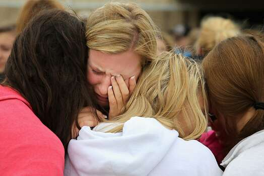 WEST, TX - APRIL 18:  West High School senior Mackenzie Wernet (C) is embraced by fellow students and friends after praying for the victims and survivors the day after the West Fertilizer Company explosion April 18, 2013 in West, Texas. Wernet's home was destroyed when the fertilizer company caught fire and exploded, injuring more than 160 people and leaving damaged buildings for blocks in every direction.  (Photo by Chip Somodevilla/Getty Images) Photo: Chip Somodevilla, Getty Images