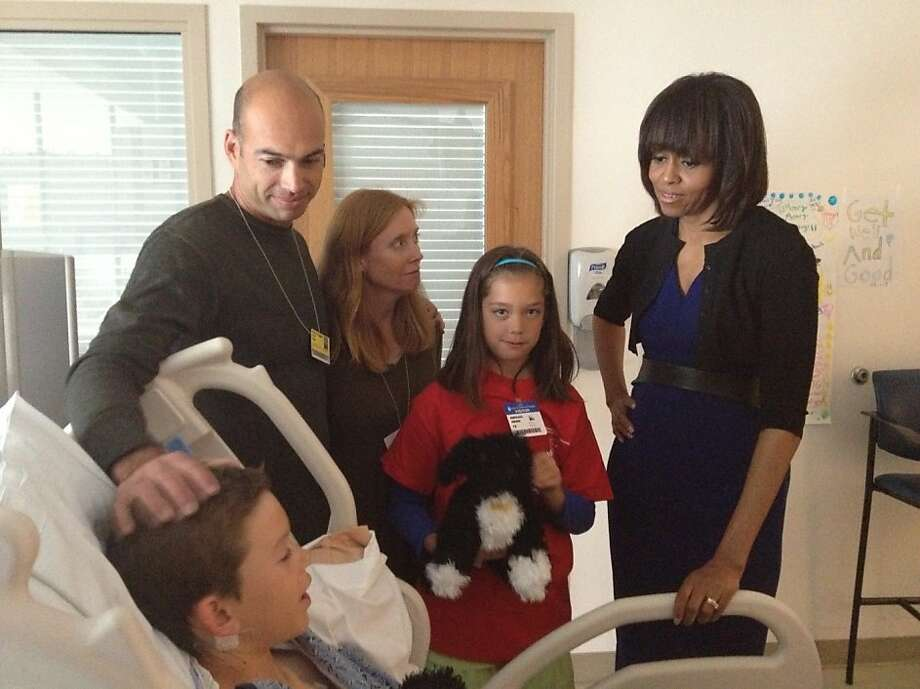 Aaron Hern and his family receive a hospital visit from first lady Michelle Obama. Photo: Courtesy Of Gay Gerlack