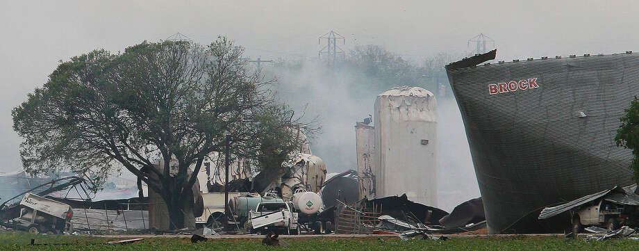 Smoke rises from the site where a fertilizer plant exploded in West, north of Waco. Photo: John Davenport / San Antonio Express-News