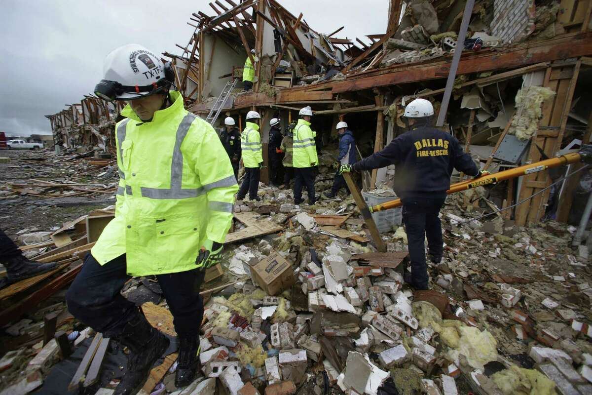 Firefighters search an apartment building destroyed by the explosion.