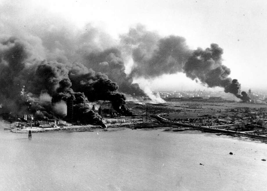 In this April 16, 1947 photo, refineries and oil storage tanks at the Monsanto Chemical Company burn in the waterfront area in Texas City, Texas. Exactly 66 years ago this week, what remains the nation's worst industrial disaster occurred when a series of explosions rocked the huge waterfront petrochemical complex at Texas City, south of Houston. At least 576 people were killed and 5,000 injured.  (AP Photo) Photo: Associated Press / AP