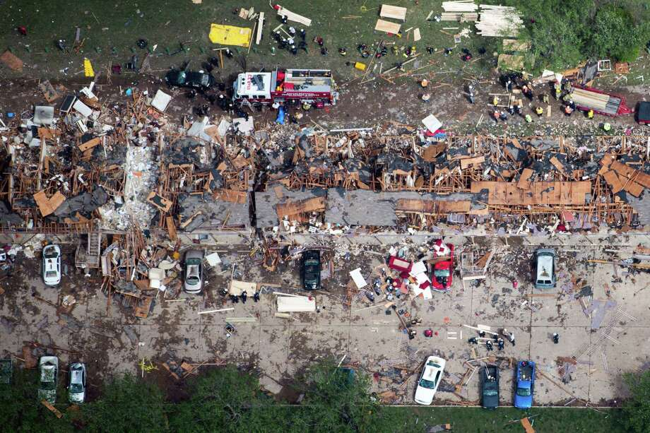 Law enforcement and rescue personnel search the damage to an apartment complex from the explosion of the West Fertilizer plant on Thursday, April 18, 2013, in West, Texas.  A massive explosion at the plant killed as many as 15 people and injured more than 160, officials said overnight. Photo: Smiley N. Pool, Houston Chronicle / © 2013  Houston Chronicle