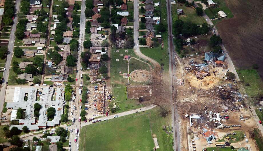 Damage from the explosion of the West Fertilizer plant, at right, is seen in an aerial view on Thursday, April 18, 2013, in West, Texas.  A nursing home is at left.  An apartment complex is at center. Photo: Smiley N. Pool, Houston Chronicle / © 2013  Houston Chronicle
