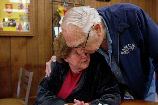 West resident Betty Tucker, 82, who owns the apartment complex that was devastated by the West Fertilizer Co. plant explosion is given a hug by friend, Jack Clements at The Village Bakery. 