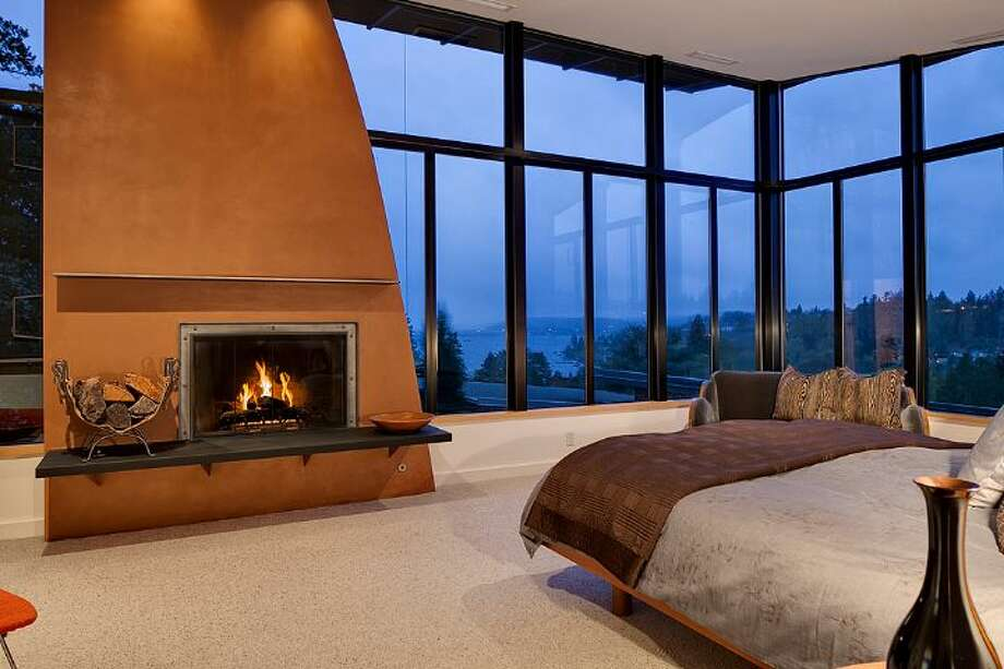 Master bedroom of 5530 60th Ave N.E. The 5,150-square-foot house, built in 1955, but extensively updated, has four bedrooms, 4.25 bathrooms, a great room, an office, three fireplaces, walls of windows, built-ins and a covered patio on more than one-third of an acre. It's listed for $2.2 million. Photo: Courtesy Mary Abbott, Windermere Real Estate