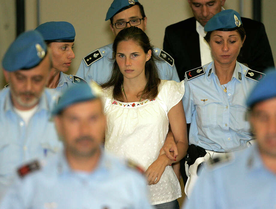Amanda Knox is led into an Italian courtroom. Photo: Seattlepi.com File, AP / AP