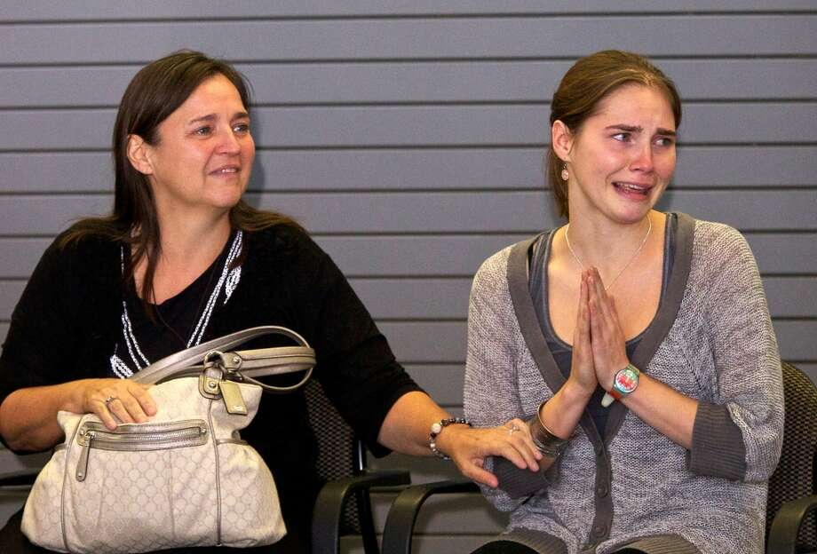 An emotional Amanda Knox upon her return to Seattle (Oct. 4, 2011). Photo: Stephen Brashear/Getty Images