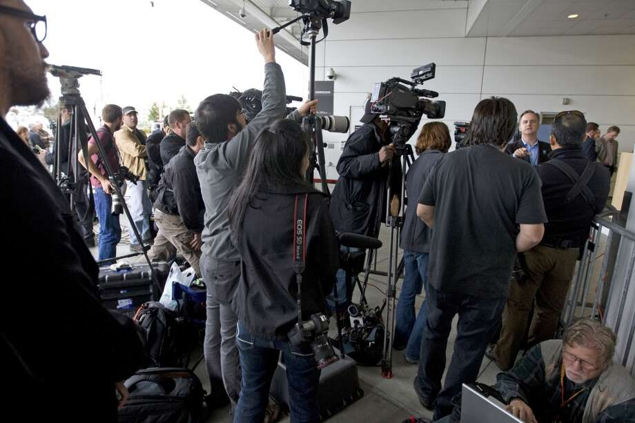 Members of the media prepare to cover Amanda Knox's homecoming to Seattle (Oct. 4, 2011).