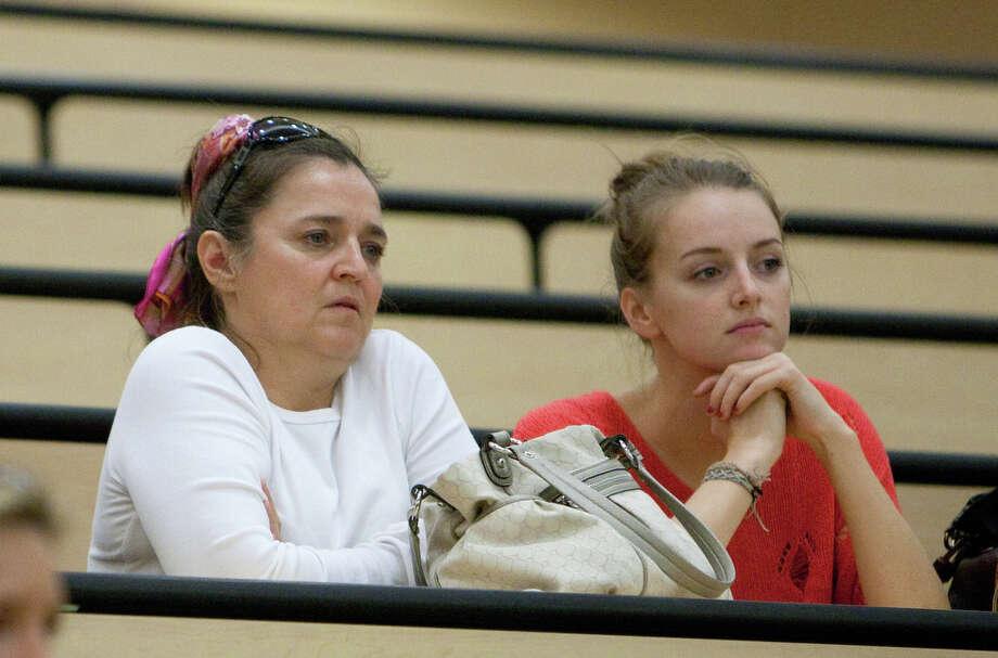 Edda Mellas, left, and Deanna Knox, the mother and sister of Amanda Knox, listen as Raffaele Sollecito speaks at the University of Washington. Photo: JOSHUA TRUJILLO / SEATTLEPI.COM