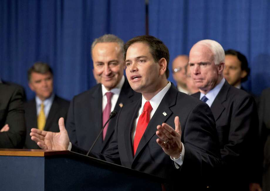 The Gang of Eight, including  Sen. Marco Rubio, R-Fla., flanked by Sen. Charles Schumer, D-N.Y., left, and Sen. John McCain, R-Ariz: It's a starting point. Photo: J. Scott Applewhite, Associated Press / AP