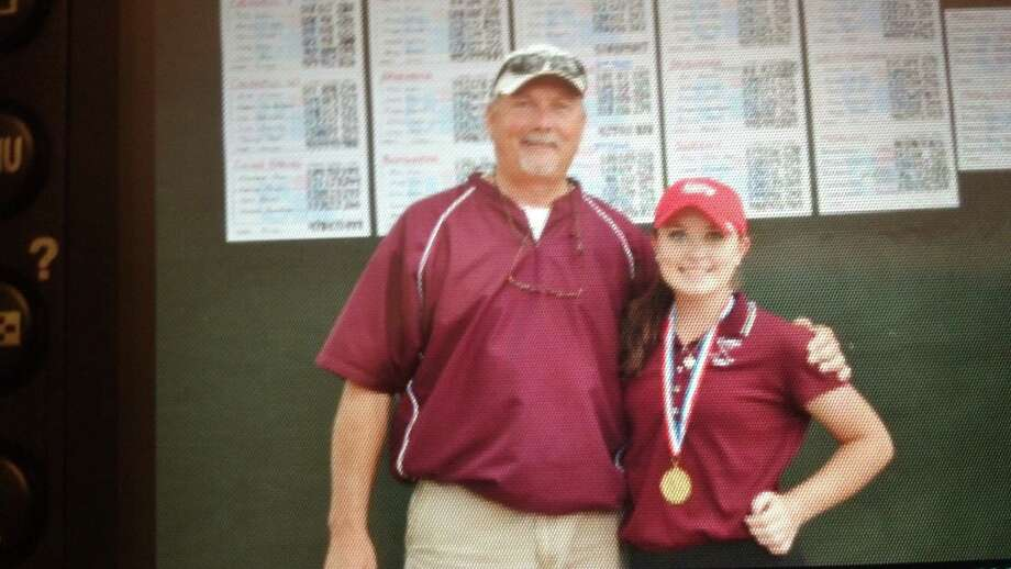 Silsbee junior Allison Davis, right, won the Class 3A Region III golf tournament on Tuesday, April 16, 2013  She is pictured with her coach Bobby Woodard. Photo: Courtesy Of Amanda Davis