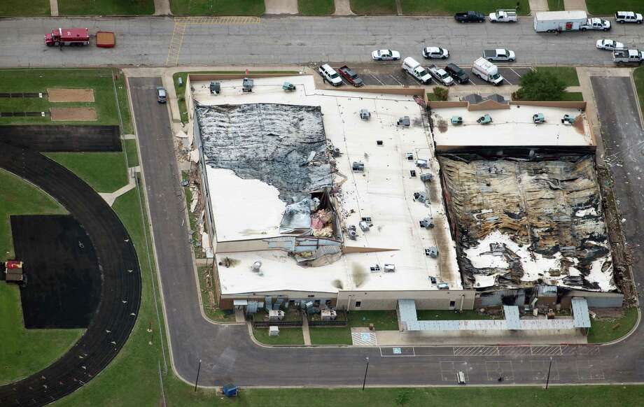 Damage to the middle school and school administration buildings from the explosion of the West Fertilizer plant is seen in an aerial view on Thursday, April 18, 2013, in West, Texas.  Photo: Smiley N. Pool, Houston Chronicle / © 2013  Houston Chronicle