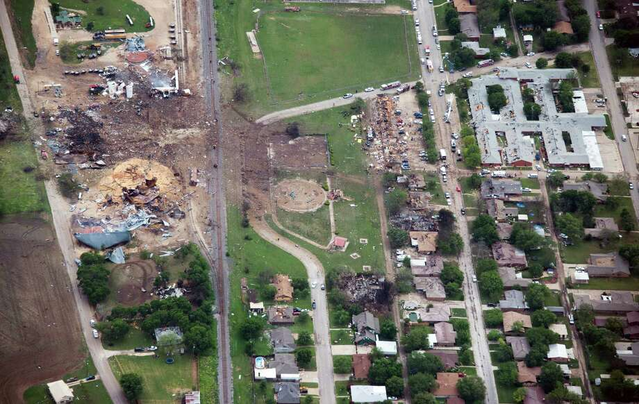 Damage from the explosion of the West Fertilizer plant is seen in an aerial view of the city on Thursday, April 18, 2013, in West, Texas.  The plant is a the left of the photo.  An apartment complex is at center.  A nursing home is at top right. Photo: Smiley N. Pool, Houston Chronicle / © 2013  Houston Chronicle