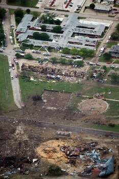Damage from the explosion of the West Fertilizer plant is seen in an aerial view of the city on Thursday, April 18, 2013, in West, Texas.  Photo: Smiley N. Pool, Houston Chronicle / © 2013  Houston Chronicle