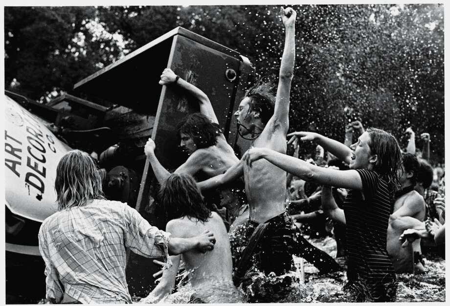 Young demonstrators (many shirtless) shout and cheer as they overturn a truck trailer in the Reflecting Pool on the Mall facing the Washington Monument during the 'Honor America Day Smoke-In' thrown by marijuana activists to protest the official 'Honor America Day' ceremonies being held at the Lincoln Memorial, Washington, DC, July 4, 1970. (Photo by David Fenton/Getty Images) Photo: David Fenton, Getty Images