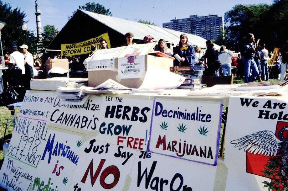"Protest signs can be seen at this booth set up during the 1998 ""Freedom Rally"" held at the Boston Common, Boston, MA on Oct. 3, 1998. Each year individuals and groups who hope to change the current marijuana laws participate in this gathering. (Photo by Bruce Preston) Photo: Bruce Preston, Getty Images"