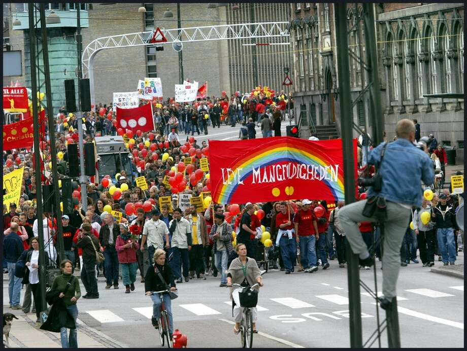 Thousands of demonstrators march through the streets of Copenhagen, Denmark, 30 August 2003 to air support for Christiania, Copenhagen's famed hippie enclave located on the attractive real estate where the government wants to build expensive homes. (Photo by KELD NAVNTOFT/AFP/Getty Images) Photo: KELD NAVNTOFT, AFP/Getty Images