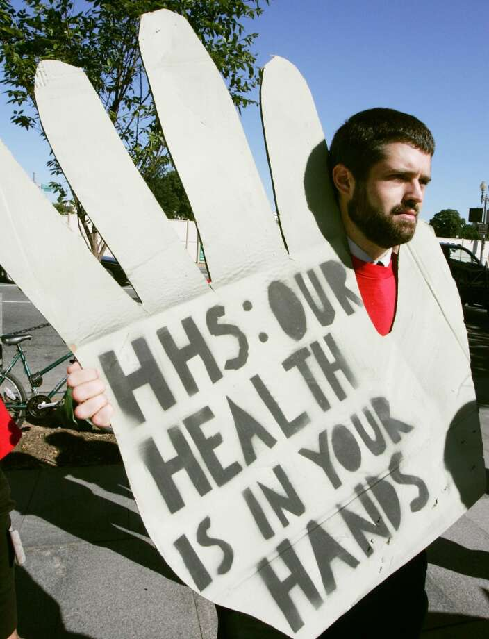 Tyler Smith holds a sign during a rally to legalize medical marijuana at the Health and Human Services Department Oct. 5, 2004 in Washington, DC. (Photo by Mark Wilson/Getty Images) Photo: Mark Wilson, Getty Images
