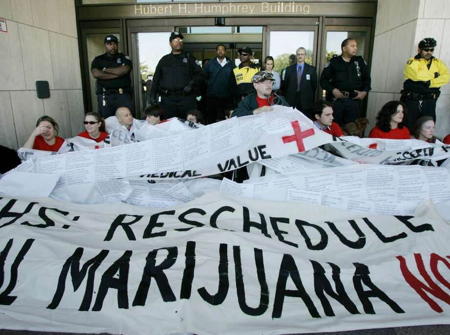 Protesters hold a banner during a rally to legalize medical marijuana at the Health and Human Services Department Oct. 5, 2004 in Washington, DC. (Photo by Mark Wilson/Getty Images) Photo: Mark Wilson, Getty Images