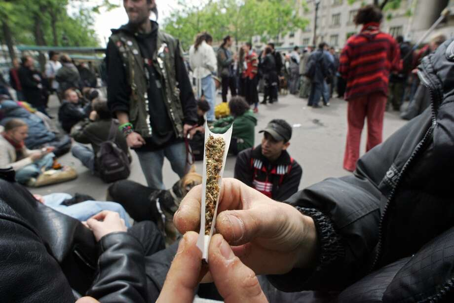 A man rolls a joint as about 200 people protest for the decriminalization of marijuana May 7, 2005 in Paris. (Photo by FRANCOIS GUILLOT/AFP/Getty Images) Photo: FRANCOIS GUILLOT, AFP/Getty Images