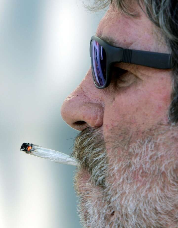 Frank Peters smokes marijuana during a demonstration in front of the San Francisco Hall of Justice July 12, 2005 in San Francisco.  (Photo by Justin Sullivan/Getty Images) Photo: Justin Sullivan, Getty Images
