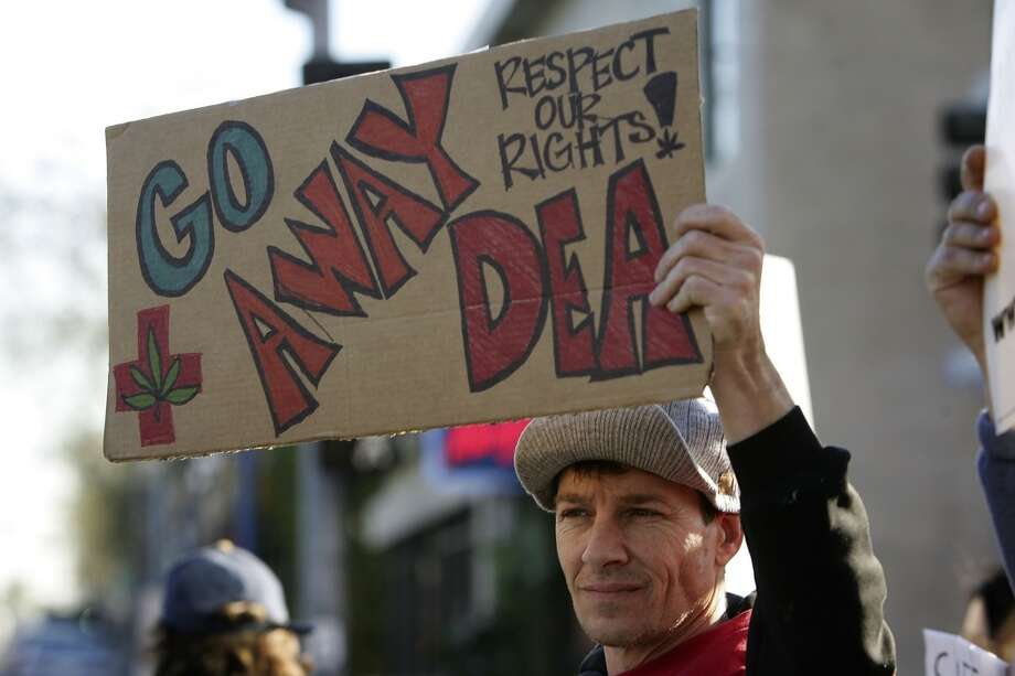 Protesters demonstrate the day after Drug Enforcement Administration raids shut down 11 medical marijuana clinics around Los Angeles County on Jan. 18, 2007 in West Hollywood, Calif. (Photo by David McNew/Getty Images) Photo: David McNew, Getty Images
