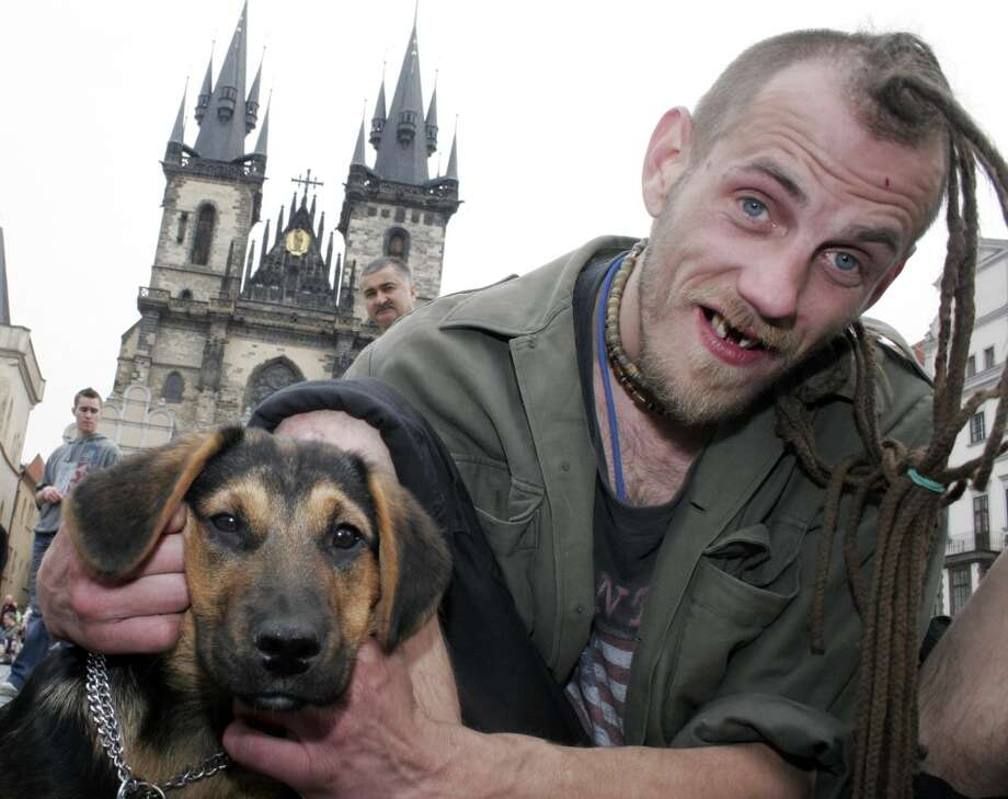 A Czech protester and his dog poses for a picture during a protest for the legalization of marijuana during the Million Marijuana March 2007 in Prague, Czech Republic. (Photo by Hana Kalvachova/isifa/Getty Images) Photo: Isifa, Getty Images