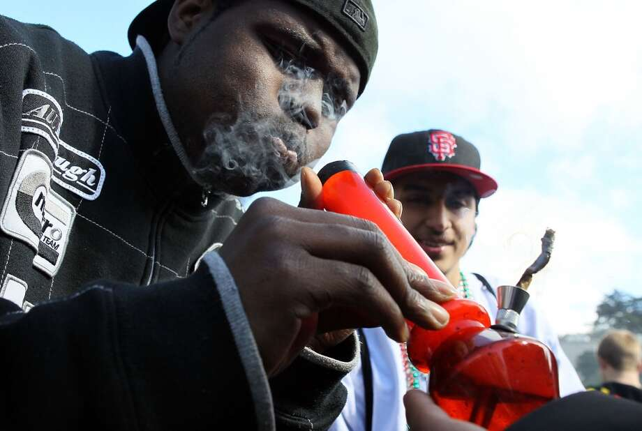"A marijuana user smokes from a bong during a 420 Day celebration on ""Hippie Hill"" in Golden Gate Park  on April 20, 2010 in San Francisco, Calif.(Photo by Justin Sullivan/Getty Images) Photo: Justin Sullivan, Getty Images"