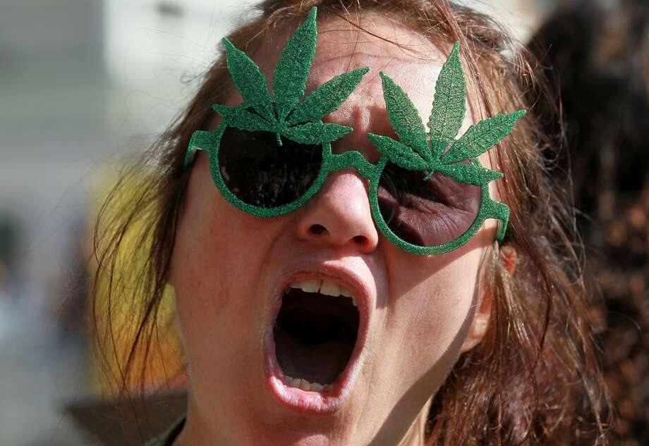 "A medical marijuana advocate who goes by the name ""The Holy Hemptress"" shouts as she demonstrates outside of the W Hotel where U.S. President Barack Obama is holding a fundraiser on Oct. 25, 2011 in San Francisco, Calif. (Photo by Justin Sullivan/Getty Images) Photo: Justin Sullivan, Getty Images"