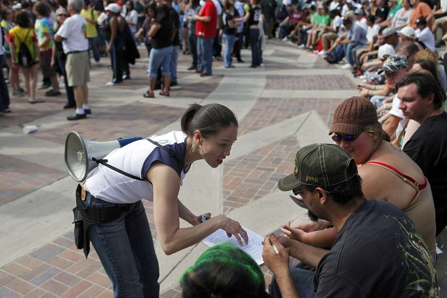 Crystal Guess of Denver, Colorado attempts to gather signatures for an initiative which would remove marijuana from the controlled substances list in Civic Center Park April 20, 2012 in Denver, Colo. (Photo by Marc Piscotty/Getty Images) Photo: Marc Piscotty, Getty Images