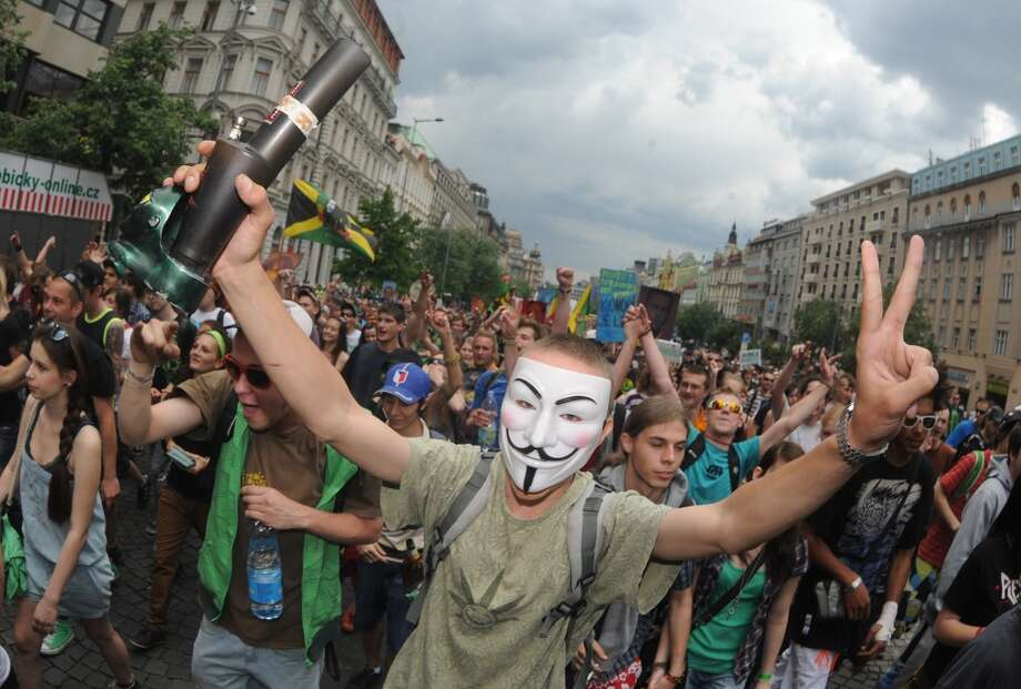 A Czech Republic youth sporting a mask and holding a water pipe shouts slogans during a march calling for the legalization of marijuana on May 5, 2012, in Prague. (Photo by MICHAL CIZEK/AFP/GettyImages) Photo: MICHAL CIZEK, AFP/Getty Images