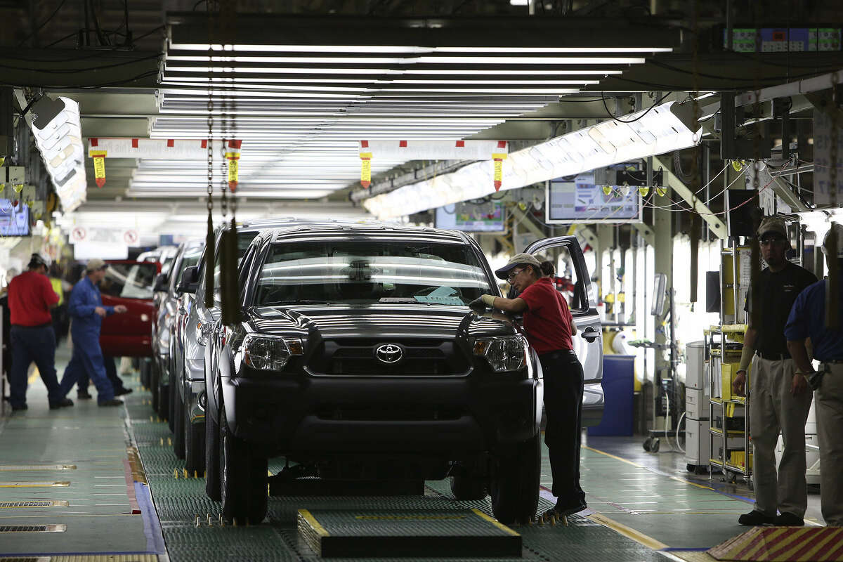 Workers keep trucks coming off the final inspection line every 63 seconds at Toyota's San Antonio assembly plant. No parallel parking is required.