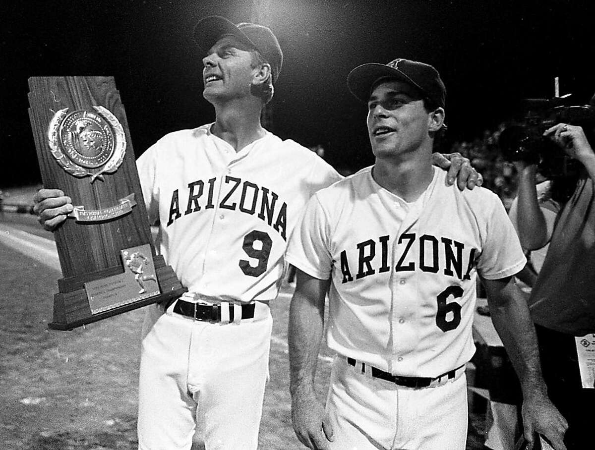 University of Arizona head coach, Jerry Kindall, left, celebrates with Chip Hale after Arizona beat Florida State, 10-2, on June 9, 1986 to win the NCAA College World Series in Omaha. photo by: Bruce McClelland/Arizona Daily Star