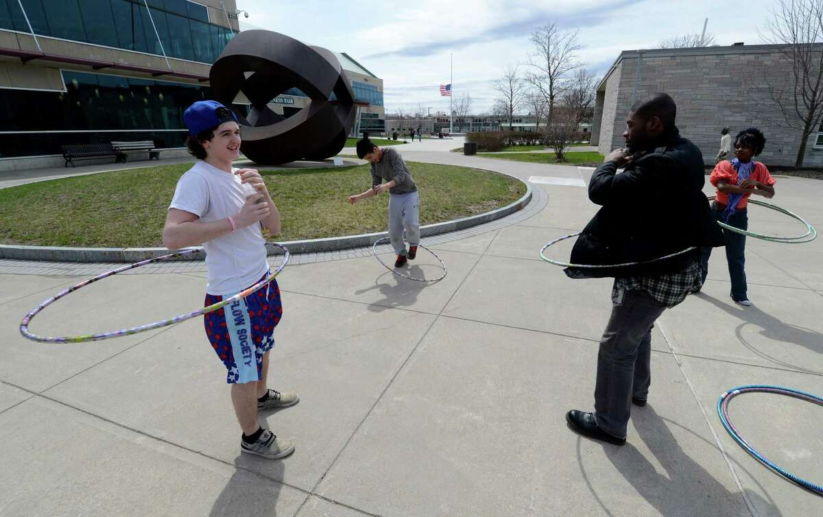 Contestants in a hula hoop competition warm up in the quad at Hudson Valley Community College Tuesday April 18, 2013 in Troy, N. Y. The competition was to twirl the hula hoop around your body and keep it moving around an obstacle course. There were very few takers in the contest. (Skip Dickstein/Times Union)
