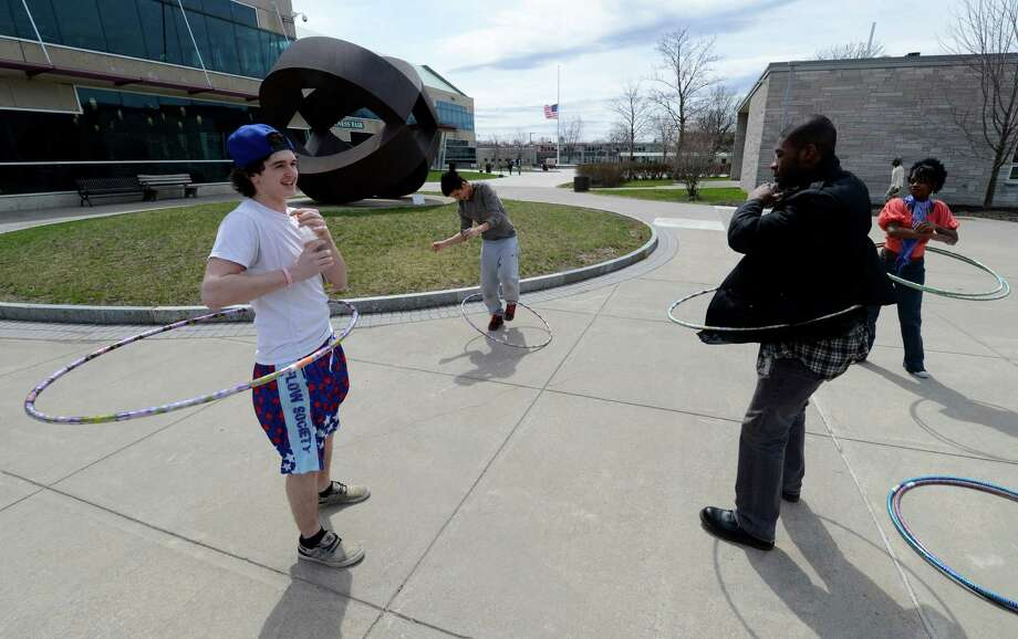 Contestants in a hula hoop competition warm up in the quad at Hudson Valley Community College Tuesday April 18, 2013 in Troy, N. Y.  The competition was to twirl the hula hoop around your body and keep it moving around an obstacle course.  There were very few takers in the contest. (Skip Dickstein/Times Union) Photo: SKIP DICKSTEIN / 0002022A