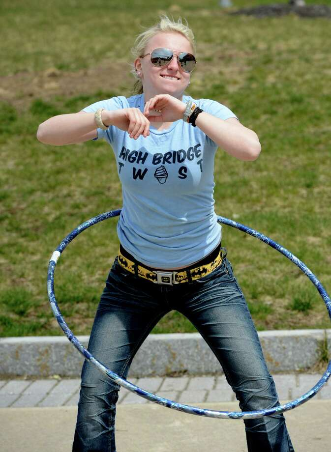 Kaylee LeBuis, 18, of Rotterdam and one of the contestants in a hula hoop competition warms up in the quad at Hudson Valley Community College Tuesday April 18, 2013 in Troy, N. Y.  The competition was to twirl the hula hoop around your body and keep it moving around an obstacle course.  There were very few takers in the contest. (Skip Dickstein/Times Union) Photo: SKIP DICKSTEIN / 0002022A