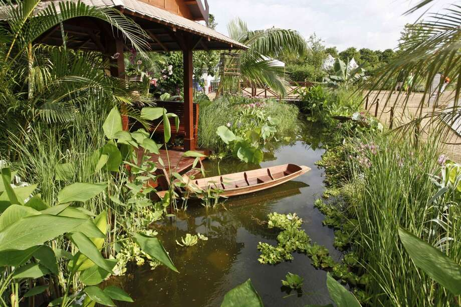 "The RHS Hampton Court Palace Flower Show can include international elements, such as this previous ""Reflections of Thailand\"" exhibit."