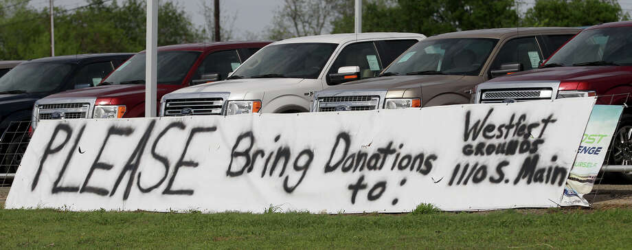 A sign in front of the Sykora Ford dealership tells passers by on Interstate 35 in West, Texas where people can bring donations to help victims of the fertilizer plant explosion. Pauline Bynum, an employee at the dealership, said donations were also being made to the first responders at the scene. Photo: JOHN DAVENPORT, SAN ANTONIO EXPRESS-NEWS / ©San Antonio Express-News/Photo may be sold to the public