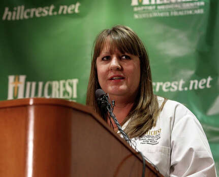 Melissa James, a social worker at Hillcrest Baptist Medical Center, has a brother and a nephew that were injured in the explosion in West, Texas. Dr. Danny Owens, a surgeon at the hospital, said patients are still coming in. Photo: JOHN DAVENPORT, SAN ANTONIO EXPRESS-NEWS / ©San Antonio Express-News/Photo may be sold to the public