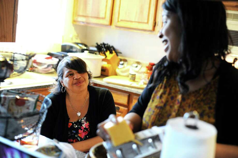 Visiting home from Humboldt State University, Imani Evans helps her disabled mother, Quanikki Van Hook, in the kitchen as they prepare food for the funeral of Imani's great grandmother earlier this month. Photo: Michael Short, Special To The Chronicle / ONLINE_YES