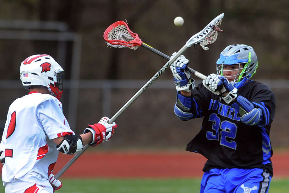 Masuk's Steve Ferrigno tries to catch a pass as Bunnell's Nick Guerra, right, converges, during boys lacrosse action in Monroe, Conn. on Thursday April 18, 2013. Photo: Christian Abraham / Connecticut Post