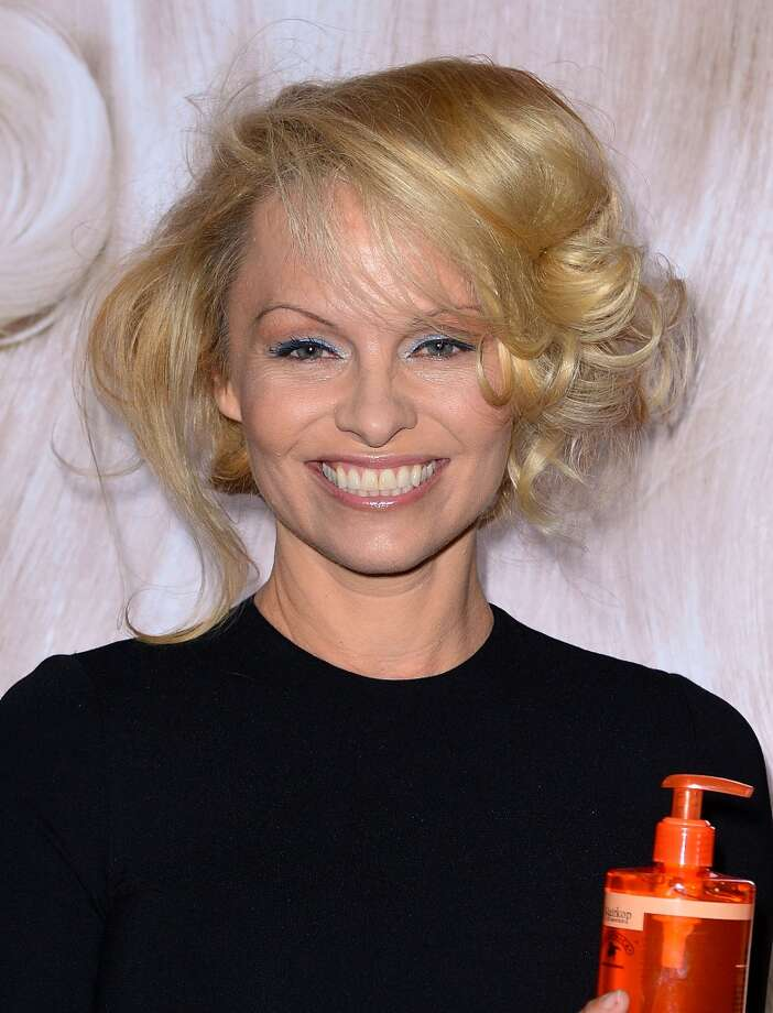 Pamela Anderson, 45, debuted this look at the International Beauty Show in New York City on April 15, 2013. Gone was the heavy hair, drag-queen make-up and breasts on full display.