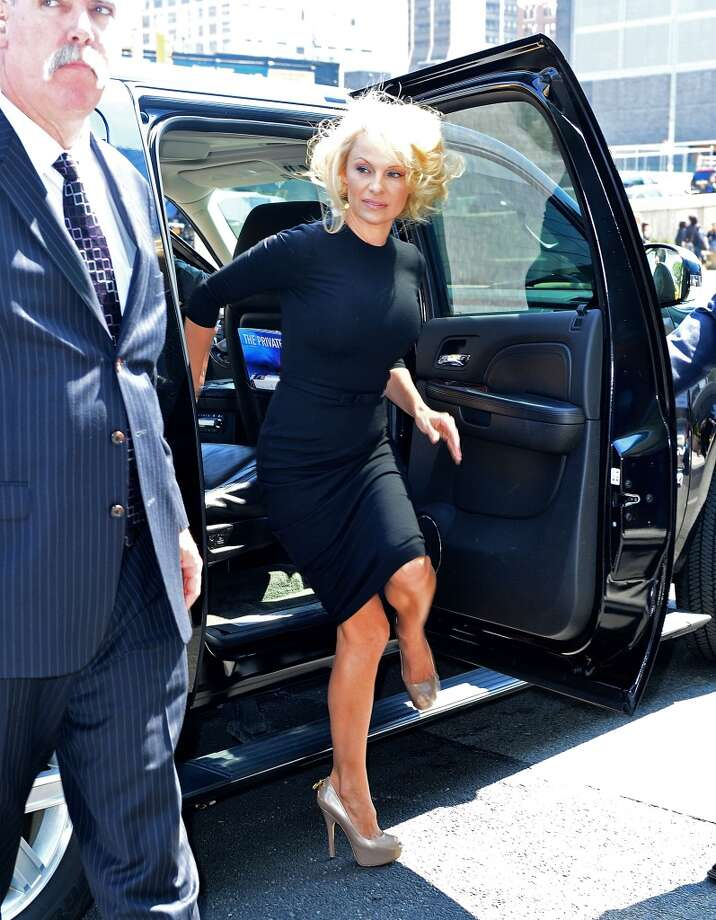 Pamela Anderson was almost unrecognizable with her new look.   On Buzzfeed, Pamela Anderson, who's appeared on the cover of Playboy 13 times, said: ''I don't know if I ever really felt beautiful...I feel like, as I'm getting older, this is my version of toned down (gestures to hair and outfit). I like it.''
