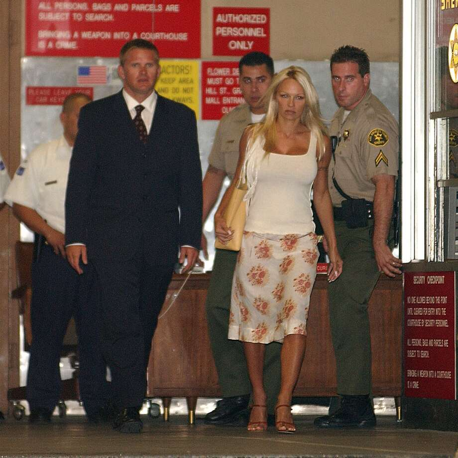 Pamela Anderson in 2002, as she leaves the Los Angeles County Courthouse after a child custody hearing with ex-husband Tommy Lee.