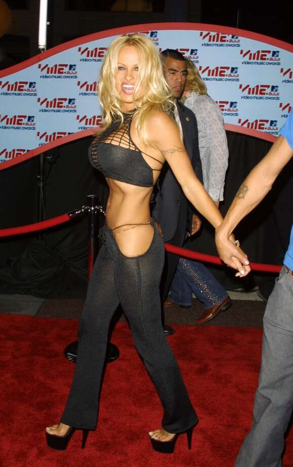 The breasts are covered, so the torso can get some air. (Pamela Anderson at the  2001 MTV Video Music Awards).