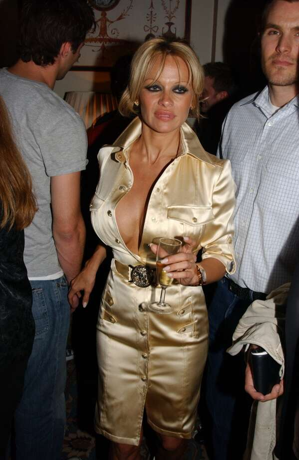 Buttons are there, but no need to use them. (Pamela Anderson, 2005 M.A.C. Cosmetics party).