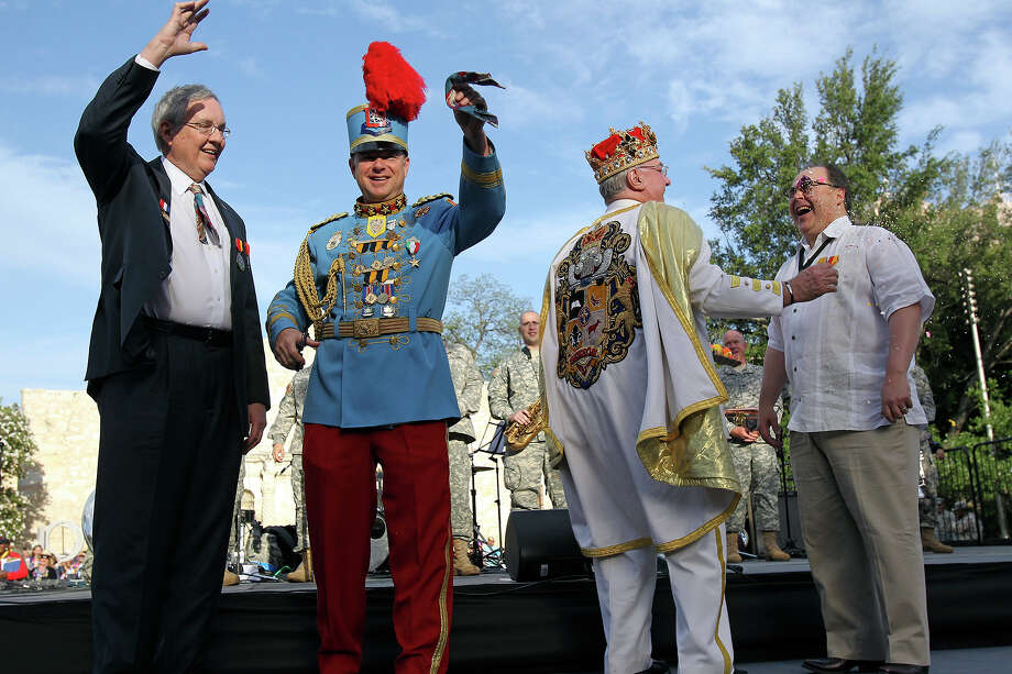 King Antonio holds the tie he cut from Bill Mock's shirt and Rey Feo, Larry Benson, Sr.  breaks a cascarone over Ramiro Cavazos as Fiesta kicks off at the Alamo with King Antonio and Rey Feo  on  April 18, 2013. Photo: TOM REEL